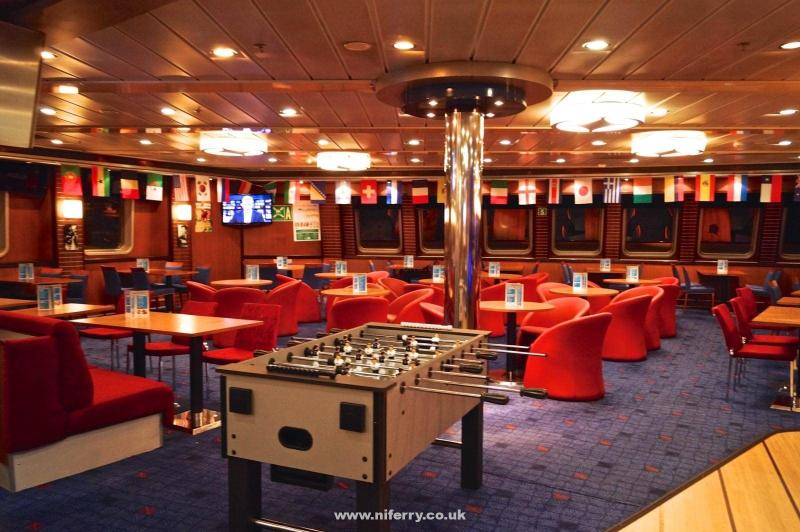 The forward seating area of the Met Bar and Grill. The Fussball table and flags are present for the Fifa World Cup 2014. © NIFerrySite