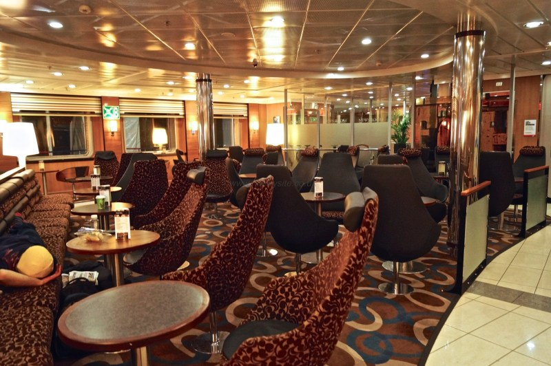 Continuing our walk towards the bow (front) of the ship, we next pass through one of the main seating areas, the Barista Coffee Shop. This view is taken from the other side looking towards the news room (the glass panels in the background). © NIFerrySite