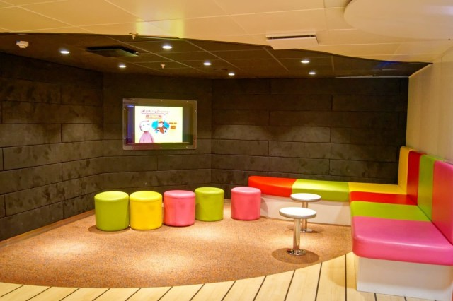 An area set aside to the side of the Family Lounge with soft furniture for children to watch Curious George videos. Copyright © Steven Tarbox