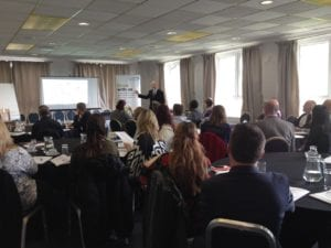 Nigel Temple delivering a marketing presentation to a group of business owners