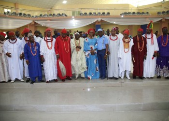 Governor Ifeanyi Okowa and wife flanked by traditional rulers of Isoko Nation