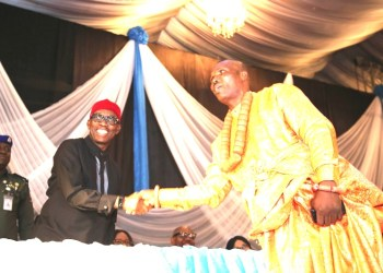 Delta State Governor, Senator Ifeanyi Okowa (left) congratulating Hon. Michael Diden, shortly after being Sworn-in as Chairman DESOPADEC, during the Swearing-in ceremony of Boards of Local Government Service Commission, DESOPADEC and the Auditor General, at Event Centre.  PIX: DELTA GOVT