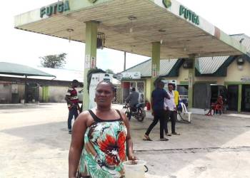 Madam Tracy when she visited the fuel station