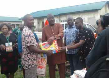 The Commissioner representing Sapele, Ethiope West , and Okpe Local Government Areas on the Board of Delta State Oil Producing Area Development Commission (DESOPADEC), Hon. Joyce Overah presenting the items to some of the beneficiaries