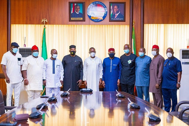 Delta Governor, Senator Dr. Ifeanyi Okowa (5th left) Minority Leader, Federal House of Representatives, Rt. Hon. Ndudi Elumelu (5th right) Hon. Julius Pondi,( left), Hon. Thomas Ereyetomi, (2ndleft), Hon. Ben Igbakpa (3rdleft)and Hon. Leo Ogor, (4thleft), Hon. Victor Nwokolo,(4th right), Hon.Ejiroghehne Uwaive(3rd right), Hon. Ossai Nicholas Ossai, (2ndright) and Hon. Efe Afe,( right) during a solitarity visit by members of Delta caucuse in the Federal House of Representatives to the Governor in Asaba . Wednesday 28/10/20.PIX: JIBUNOR SAMUEL.