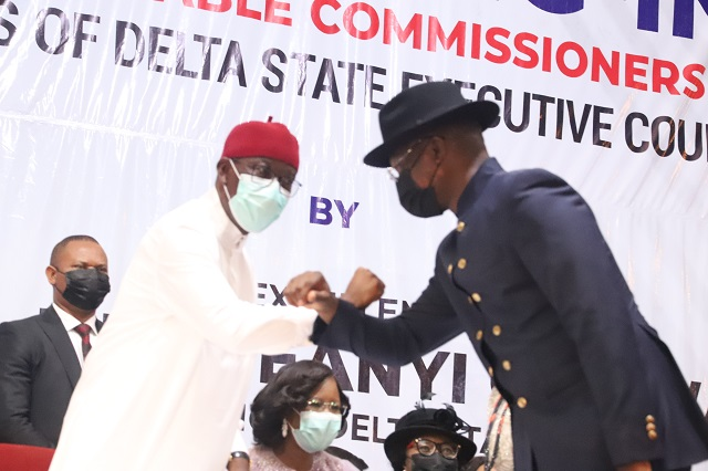Governor Ifeanyi Okowa and Mr Charles Aniagwu during the swearing in of commissioners