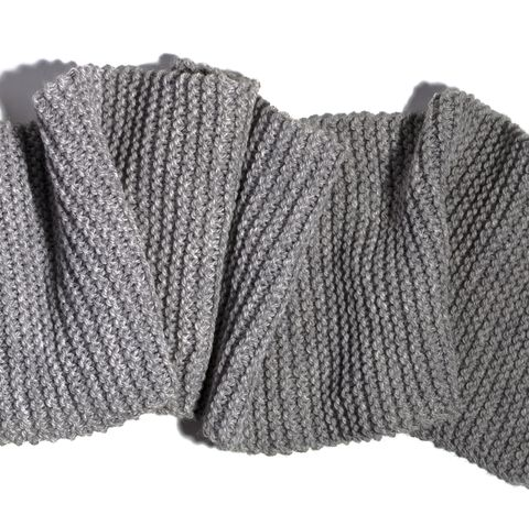 high angle view of gray woolen scarf on white royalty free image