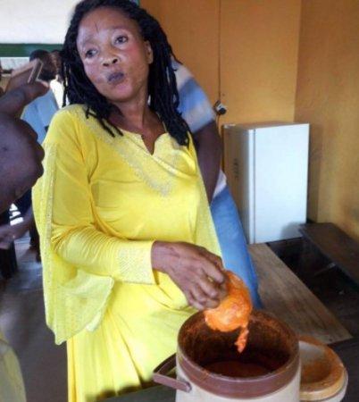 woman hides phone in soup.JPG