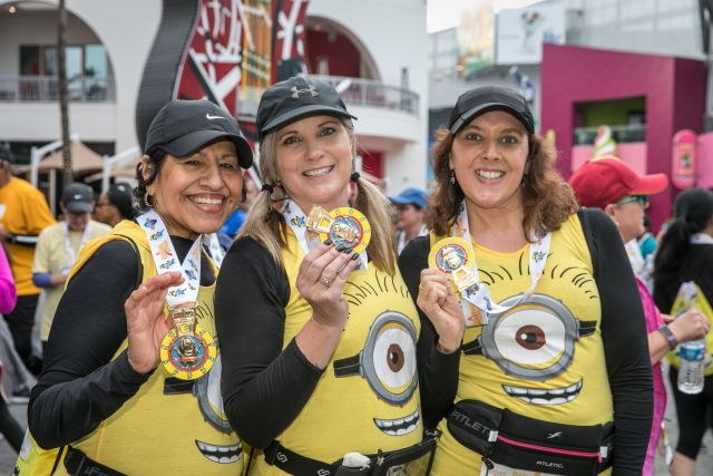 Racers show off their commemorative medals after completing the Minion 5K!