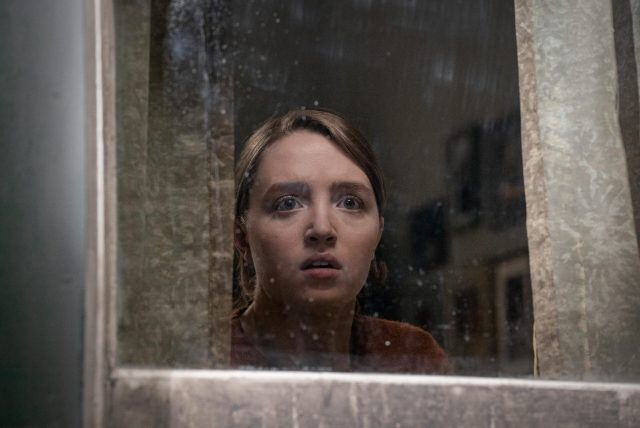 Chloe looks out the window in preparation for her mom's return in the thriller, RUN