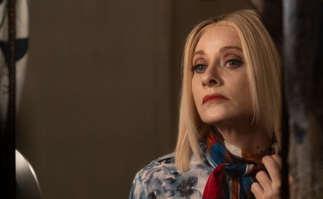 Barbara Crampton as Anne, inspecting a bite mark on her neck.