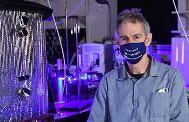 Researcher sits in his lab