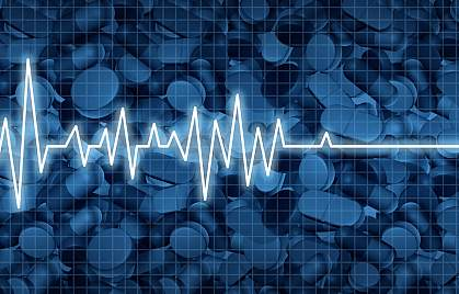 Illustration of an electrocardiogram of cardiac arrest on a background of pills