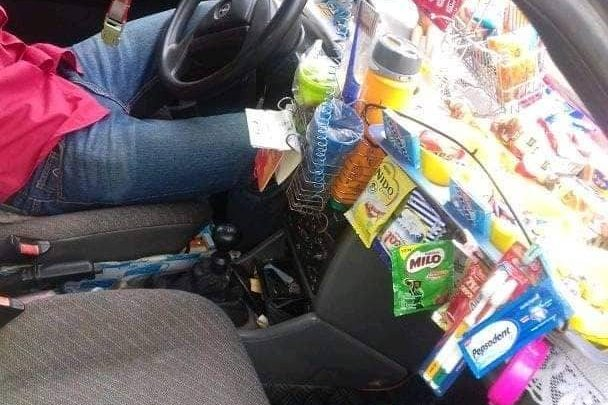 TAXI DRIVER SETS UP 'PROVISION STORE' IN HIS CAR
