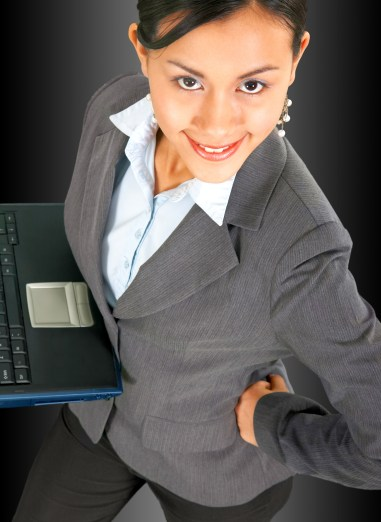 Successful Confident Business Woman Using A Notebook Computer