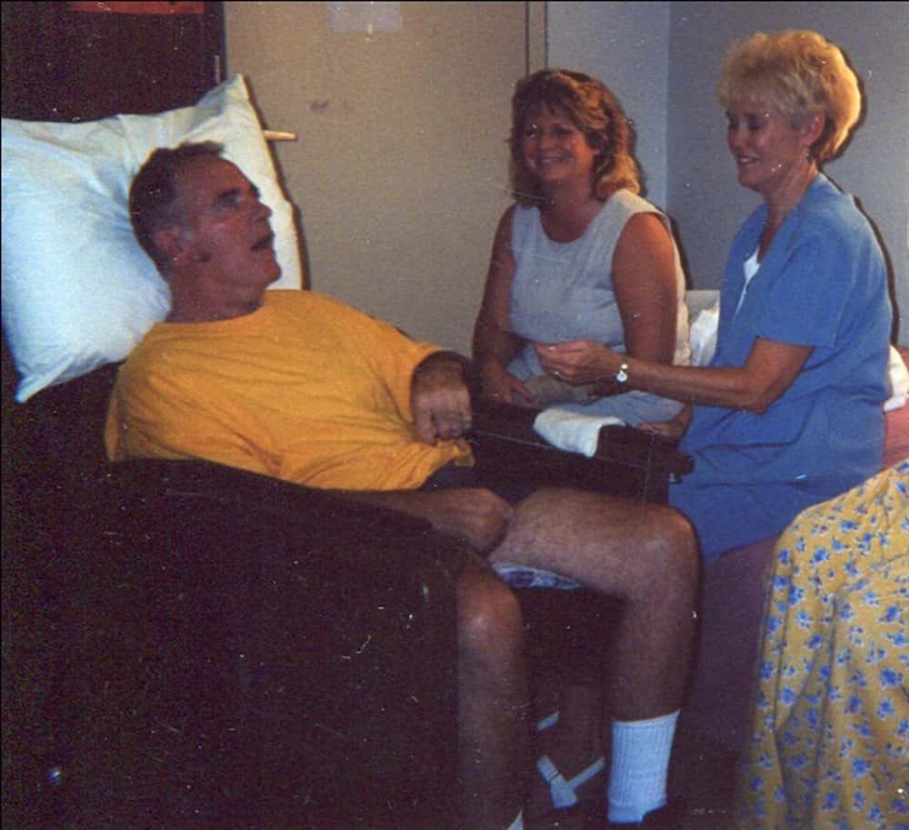 Jerry DeMoe near the end of his life, with his wife, Sharon. In the background is his niece, Colleen Miller, who also inherited the mutation.