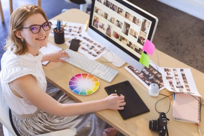 young-caucasian-female-graphic-designer-working-on-F7SDUEX.jpg