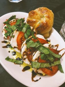 The caprese salad and garlic knots at Aglio e Olio restaurant in Seattle.