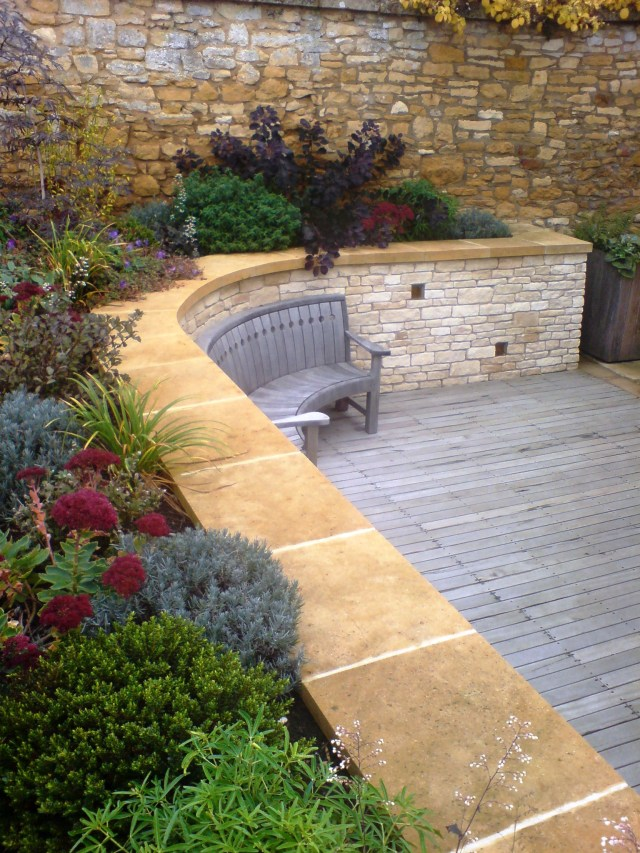 cotswold stone retaining wall for garden studio