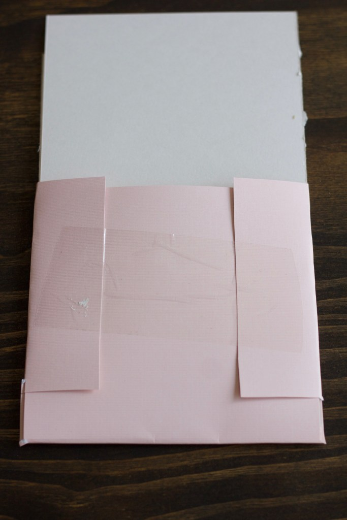 Use tape to secure the folder for your bridesmaid proposal info cards