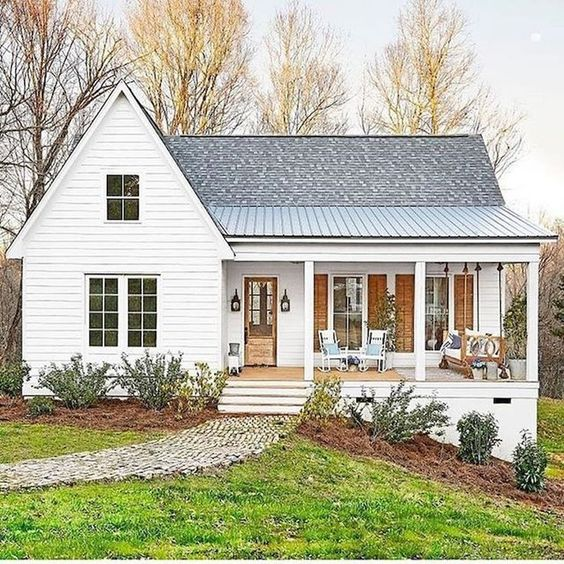 This country style front porch adds the perfect farmhouse touch to the exterior of this home