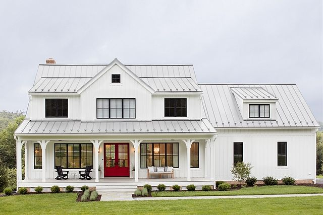 I love the look of the tin roof on this farmhouse style home, its the perfect color contrast with the all-white exterior!