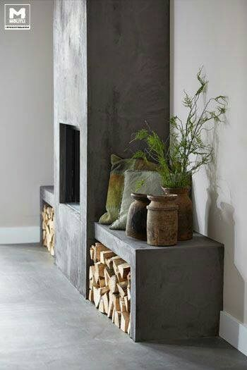 Stylish Ways To Store Wood in Your Home; cute and high style ways to hide or display wood in your home when you have a fire place or a wood burning stove. Bring on the heat and adorable piles of wood! #woodstove #fireplace #storingwood #woodpiles