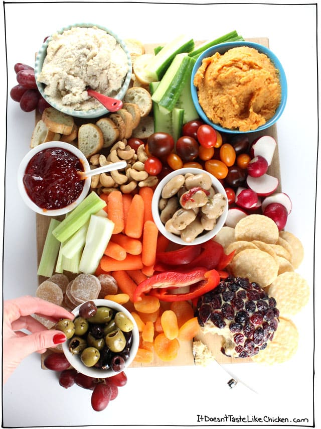 Vegan Charcuterie Board Ideas; options for a appetizer platter to please everyone in the family! Stay healthy this holiday season with this spread of goodies #charcuterieboard #veganappetizers #cheesefree #vegetarianappetizers || Nikkisplate.com