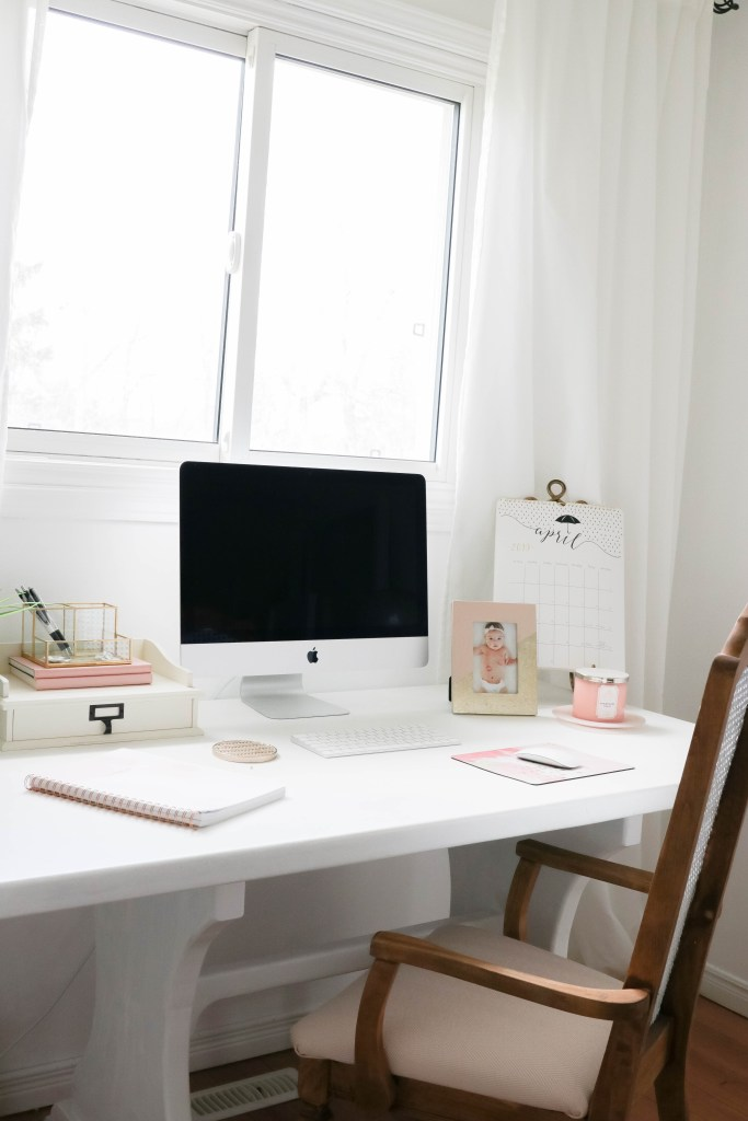 Girly White office with vintage wood chair, iMac computer, greenery, tall calendar, white vintage chair, daughter framed picture, white linen drapes || Nikki's Plate