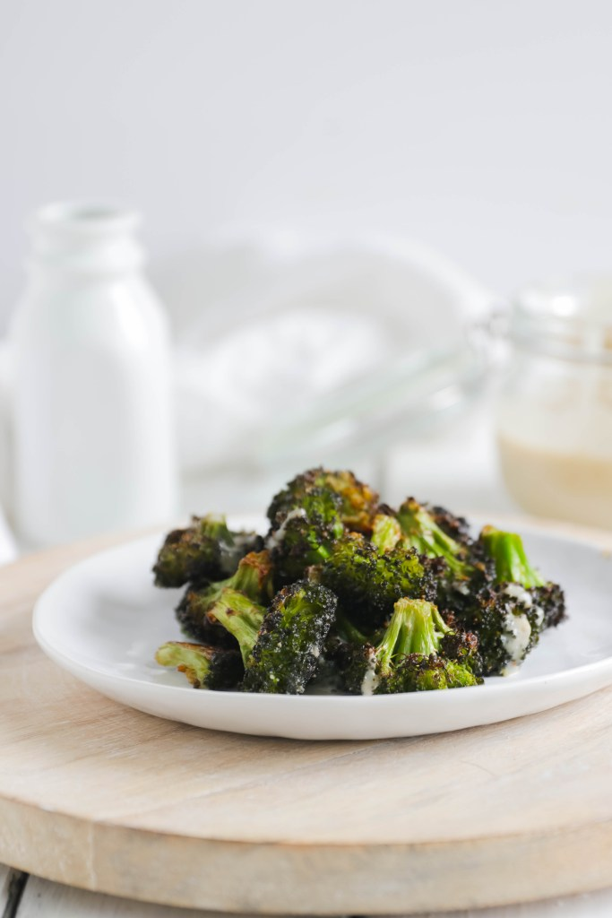 Crispy Broccoli with Vegan Cheese Sauce; dairy and gluten free side dish for your vegan dinner! A nut free cheese sauce that you will love smothered on your blackened broccoli!