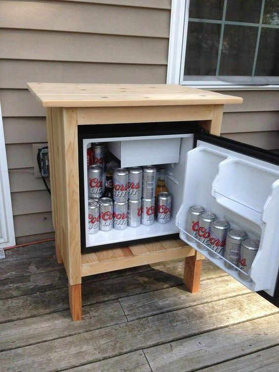 15 Deck Must Haves for Summer Entertaining; outdoor fridge, cooler, beer cooler, DIY wood fridge