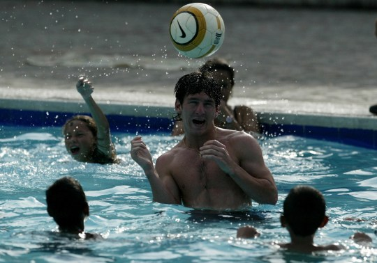 Argentine Lionel Messi plays with young fans at a swimming pool in Pereira, February 3, 2005. Argentina will play against Brazil on Sunday in Manizales. REUTERS/Albeiro Lopera EM Reuters / Picture supplied by Action Images *** Local Caption *** RBBORH2005020301132.jpg