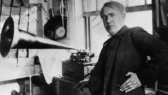 Thomas Alva Edison (1847 - 1931) with the his invention, the phonograph. (Photo by Hulton Archive/Getty Images)