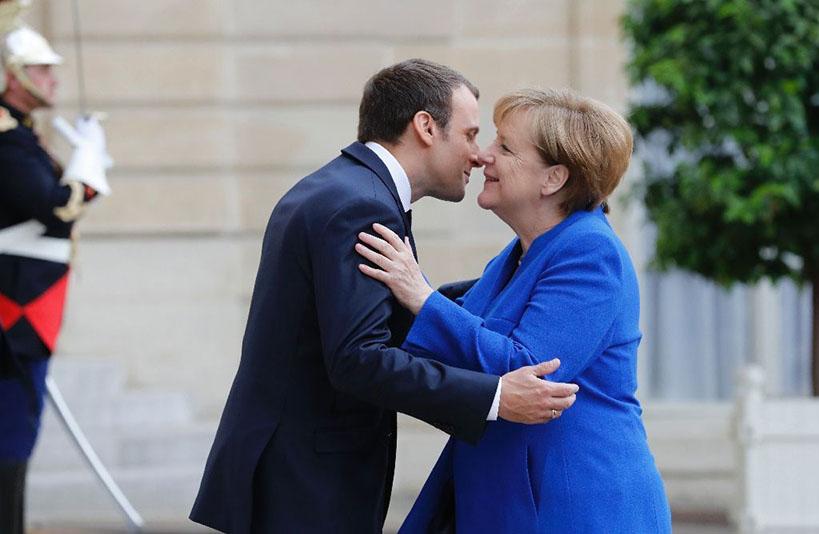 Namaste-Is-the-New-Handshake-Will-COVID-19-Redefine-Greeting-Etiquette-Merkel-Marcon-kissing