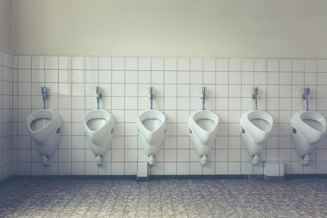 urinals on the toilet wall