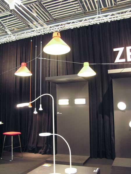 Lamps on horizontal metal hangings.