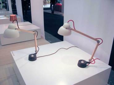 Table lamps with wooden arms.