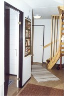 To the left the extra room. In front stairs to upstairs. In between door to the basement room.