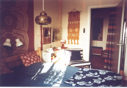That bedspread still exists. The yellow makramé on the wall was made by me.