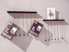 This should be really easy to do yourself for hanging your magazines.