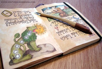 The open pages of the Alchemy notebook with the hand made dip pen used to drawn the designs.