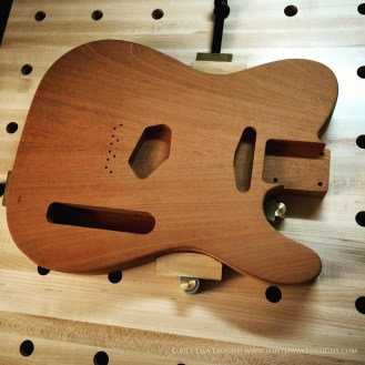This is the original Tele-style guitar body in Honduran mahogany which I purchased pre-drilled and routered for the guitar components.