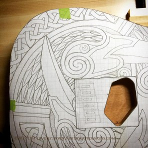 I photocopied the drawing to use as a template and used the copy to transfer the design to the guitar body.