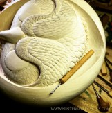 The micro carving tool used to add the feather details.