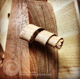 The first lovely curl of mahogany.