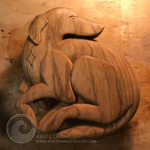The completed carving with oil and wax finish.