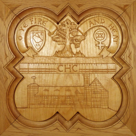 "SPS Form of 1991 Plaque, 11.25"" x 11.25"", stained basswood. 11.25"" x 11.25"", painted basswood."