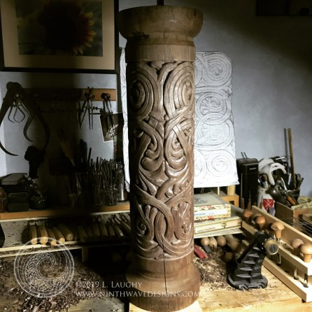 The finished column in raking light to show the way the light catches the design.