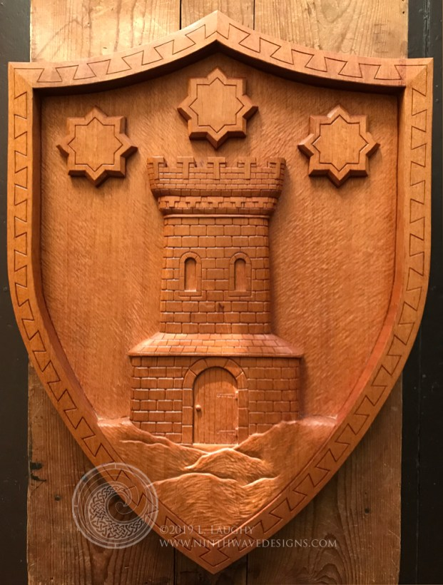 Tower and Stars family shield carved in mahogany.