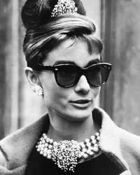 Audrey Hepburn wearing Pearls and sunglasses